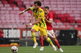 epa08465828 Benfica's player Adel Taarabt (R) in action against Tondela's oponent Yohan Tavares (L) during their Portuguese First League soccer match, held at the Luz stadium in Lisbon, 04 June 2020. EPA/TIAGO PETINGA